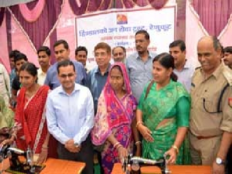 Sewing machines, bicycles distributed Trai