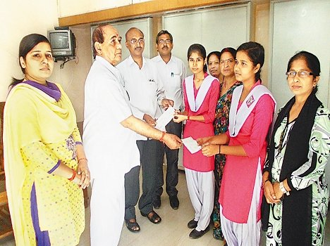 scholarship cheques were distributed aming students