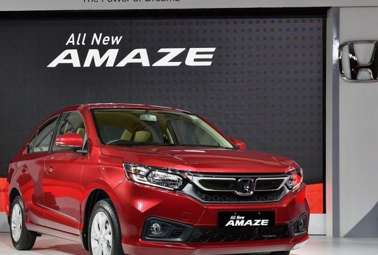 honda launches new amaze, will take on swift dzire