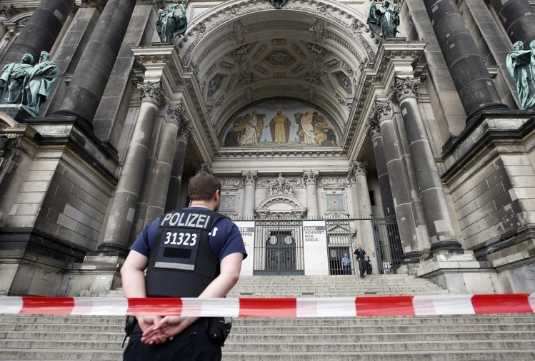 know why German police shot a man in the church