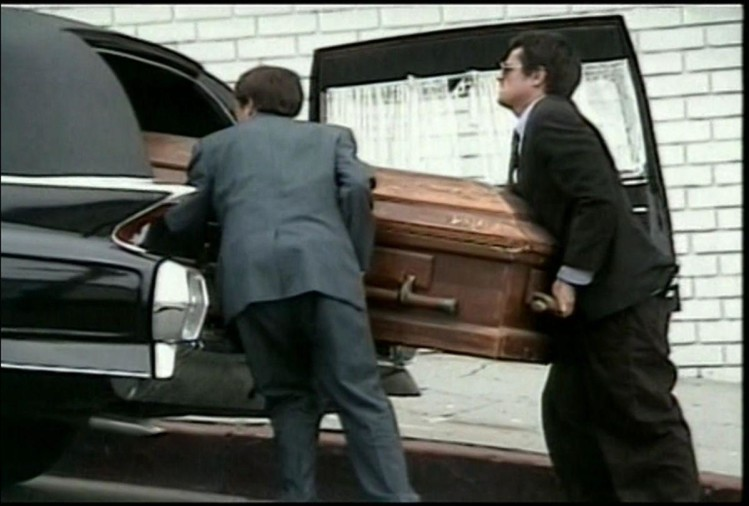 coffin in car
